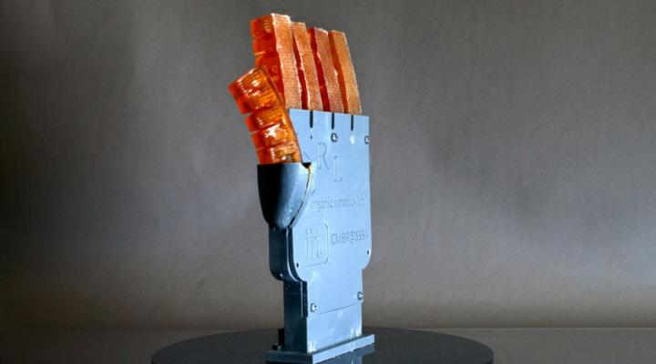 3D-printed hand with hydraulically controlled fingers that can cool itself by sweating.