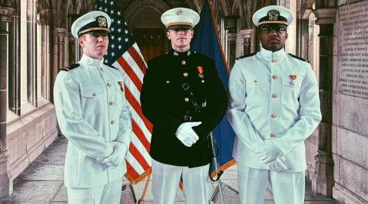 From left, Navy Ensign William Wilkinson '20, U.S. Marine 2nd Lt. Fletcher Kirol '20 and Navy Ensign Marcus Hussey '20 pose at the Cornell War Memorial during their commissioning ceremony May 22.